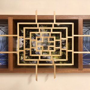 "Eva M. Capobianco • <em>FLT – Map 19, Lattice, Trees and Tower</em> • Photos and re-used wood • 24""×12""×4"" • $475.00 • <a class=""purchase"" href=""https://state-of-the-art-gallery.square.site/product/eva-m-capobianco-flt-map-19-lattice-trees-and-tower/274"" target=""_blank"">Buy</a>"