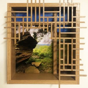 "Eva M. Capobianco • <em>FLT – Map 30, Boulder with Lattice</em> • Photo, stained glass and re-used wood • 15""×17""×3½"" • $525.00 • <a class=""purchase"" href=""https://state-of-the-art-gallery.square.site/product/eva-m-capobianco-flt-map-30-boulder-with-lattice/275"" target=""_blank"">Buy</a>"