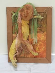 """Mary Ann Bowman • <em>Lovely Green Hair</em> • Wood, fabric • 14""""×18""""×4½"""" • $675.00<a class=""""purchase"""" href=""""https://state-of-the-art-gallery.square.site/product/mary-ann-bowman-lovely-green-hair/299"""" target=""""_blank"""">Buy</a>"""