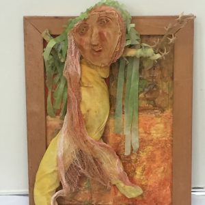 "Mary Ann Bowman • <em>Lovely Green Hair</em> • Wood, fabric • 14""×18""×4½"" • $675.00 • <a class=""purchase"" href=""https://state-of-the-art-gallery.square.site/product/mary-ann-bowman-lovely-green-hair/299"" target=""_blank"">Buy</a>"