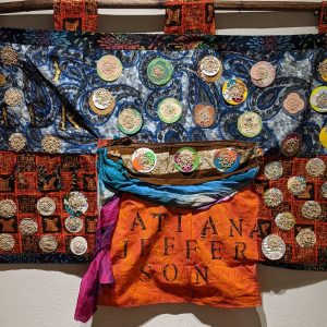 """Leanora E. Mims • <em>Say Her Name: Atiana Jefferson—Bullet Proof Soul</em> • Mixed media quilted wall hanging • 23""""×19½"""" • $900.00 • <a class=""""purchase"""" href=""""https://state-of-the-art-gallery.square.site/product/leanora-e-mims-say-her-name-atiana-jefferson-bullet-proof-soul/383"""" target=""""_blank"""">Buy</a>"""