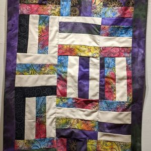 """Leanora E. Mims • <em>Sunrise, Quilted Wall Hanging</em> • Gees bend quilting pattern • 23""""×48"""" • $950.00 • <a class=""""purchase"""" href=""""https://state-of-the-art-gallery.square.site/product/leanora-e-mims-sunrise-quilted-wall-hanging/385"""" target=""""_blank"""">Buy</a>"""