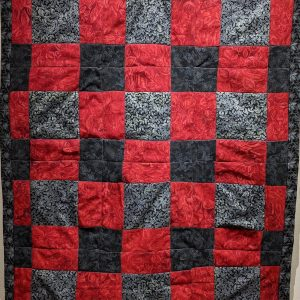 """Leanora E. Mims • <em>Say Her Name—We Will Remember You</em> • Cross square quilting pattern • 26½""""×43"""" • $800.00 • <a class=""""purchase"""" href=""""https://state-of-the-art-gallery.square.site/product/leanora-e-mims-say-her-name-we-will-remember-you/384"""" target=""""_blank"""">Buy</a>"""
