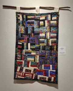 """Leanora E. Mims • <em>Say Their Names: We Will Remember Everyone</em> • 19""""×35"""" • $950.00<a class=""""purchase"""" href=""""https://state-of-the-art-gallery.square.site/product/leanora-e-mims-say-her-name-we-will-remember-everyone/382"""" target=""""_blank"""">Buy</a>"""