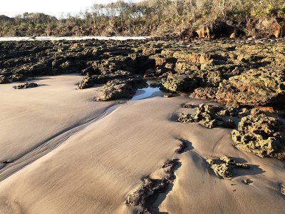 "Eva M. Capobianco • <em>Rocks and Sand, Big Talbot Island, FL</em> • Digital photo on aluminum plate • 8½""×11"" • $75.00"