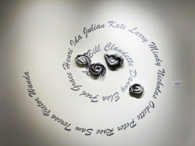 """Christine Chin • <em>Stuffed Storms: 2021 Atlantic Tropical Storm Season</em> • Stuffed and quilted archival ink prints on fabric with hand embroidery. • 138""""×72""""×2"""" • $2,500.00<a class=""""purchase"""" href=""""https://state-of-the-art-gallery.square.site/product/christine-chin-stuffed-storms-2021-atlantic-tropical-storm-season/584"""" target=""""_blank"""">Buy</a>"""